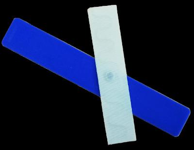 two blue neoprene fabric tags