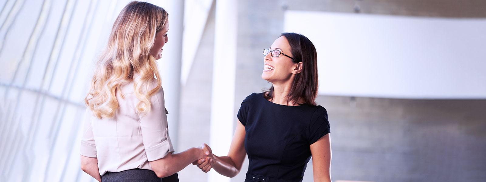 employees shaking hands_interview
