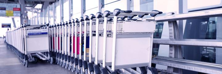 airport trolleys lined up at airport