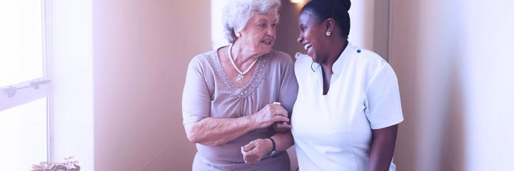 wandering patient, lady in care home with nurse