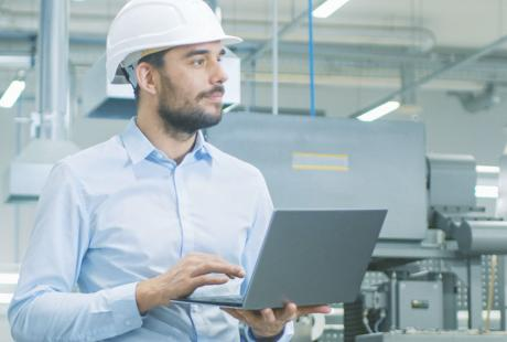 employee in warehouse monitoring production